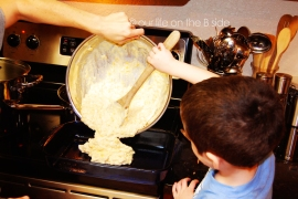 Pouring Corn Casserole Mixture